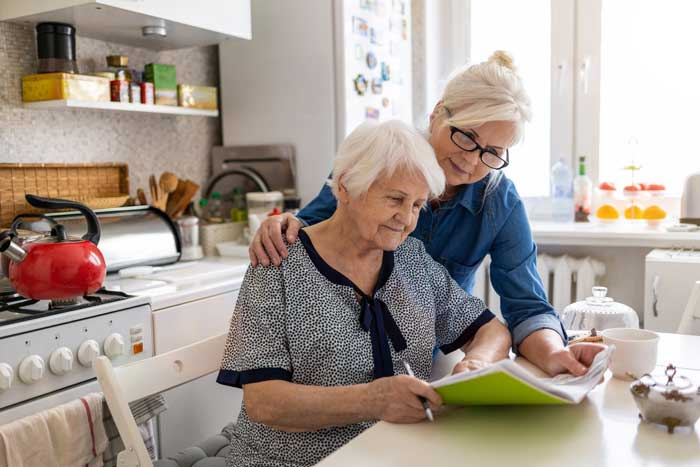 A daughter who is a caregiver helps her mom read through her Medicare coverage after learning SelectQuote's helpful tips